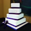 Monogrammed White Fondant Cake with Purple Ribbon
