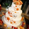 Orange Flower and Monogram Wedding Cake