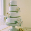 Wedding Cake with Green Ribbon and Daisies