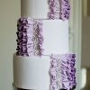 White Wedding Cake with Purple Ruffles