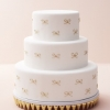 Wedding Cake with Gold Bows