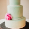 Green Wedding Cake with a Pink Flower