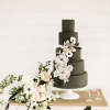 Black Wedding Cake with Cascading White Flowers