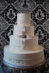 Scroll pattern white wedding cake