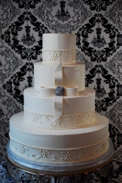 Scroll pattern white wedding cake