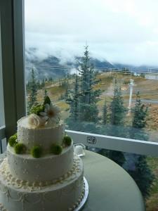 White wedding cake with green mums