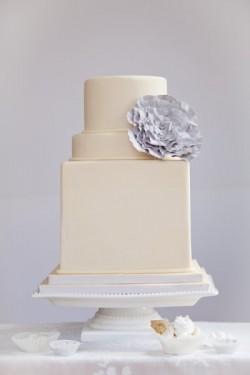 Square and round white wedding cake