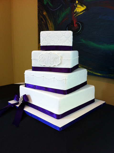 square wedding cake with purple ribbon monogrammed white fondant cake with purple ribbon a 20438