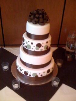 Brown polka dot and bow cake