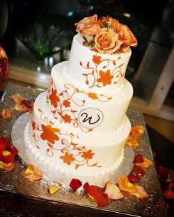 orange monogram wedding cake