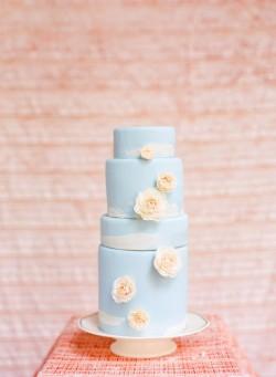 blue wedding cake with white roses