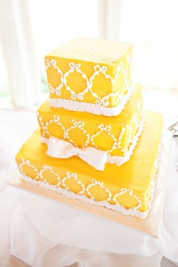 yellow ruffled ribbon square wedding cake