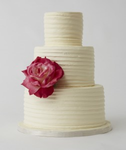 white cake with red rose