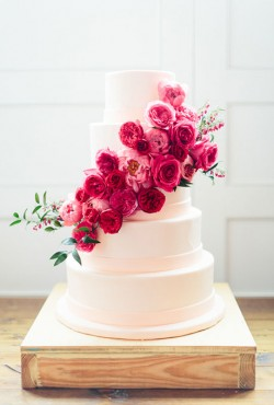 white cake with pink flower cascade