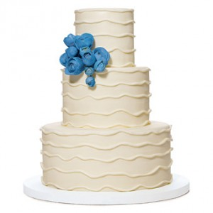 white cake with blue flowers