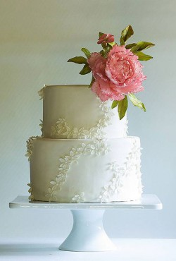 lacy wedding cake with flower
