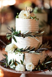 white cake with greens and flowers