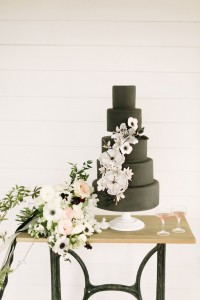 black cake with white flowers